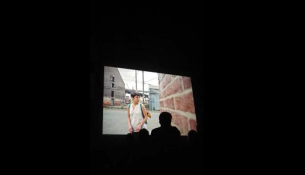 Migrantes, Projection at the opening of twentieth Festival Voies Off, Cour de l'Archevêché, Arles, 2015